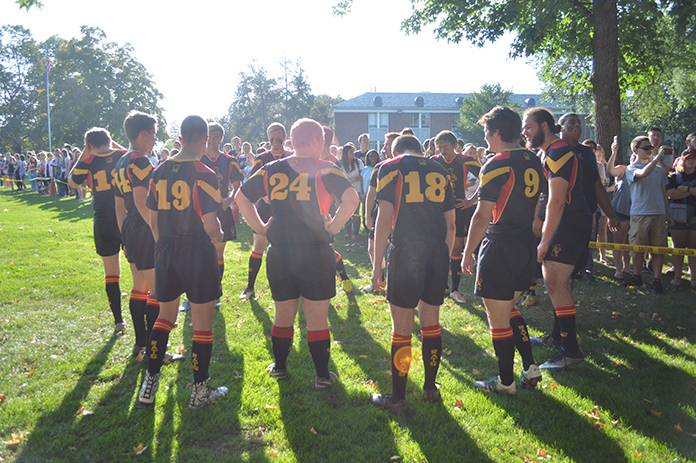 Rugby team huddled
