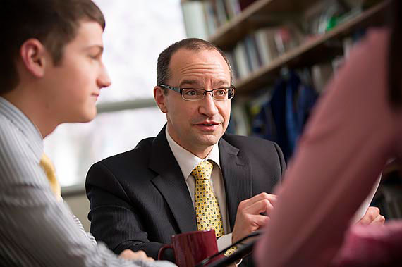 Accounting Professor Dom Peruso advising students
