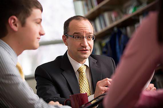 Accounting Professor Dom Peruso advising students