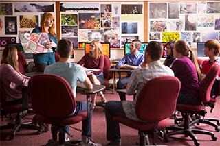 Juniata College IMA professor Ryan Gibboney leads a student critique