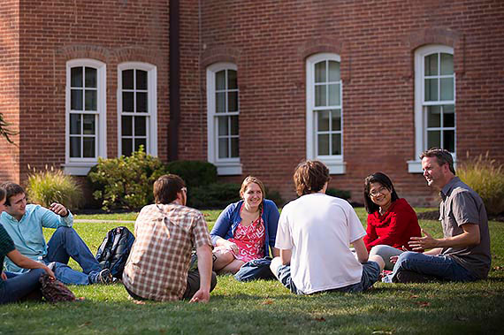 Juniata College Phsychology professor Mark McKellob and students holding class in front of Founders Hall