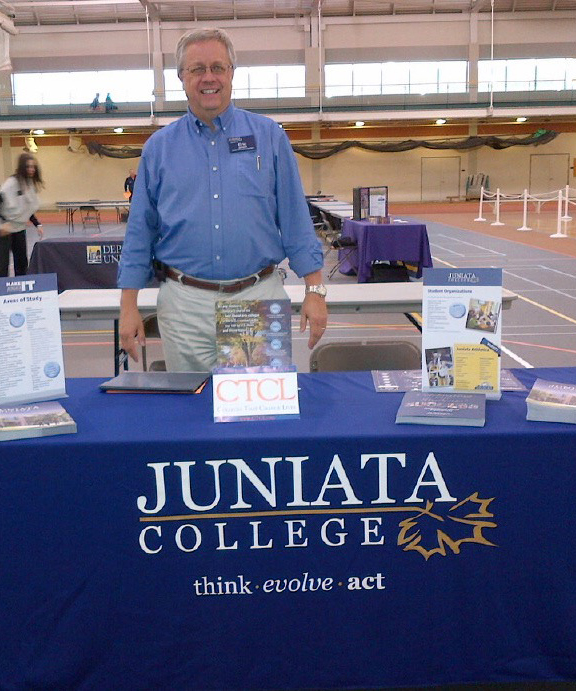 Eric Jensen representing Juniata College at a College Fair