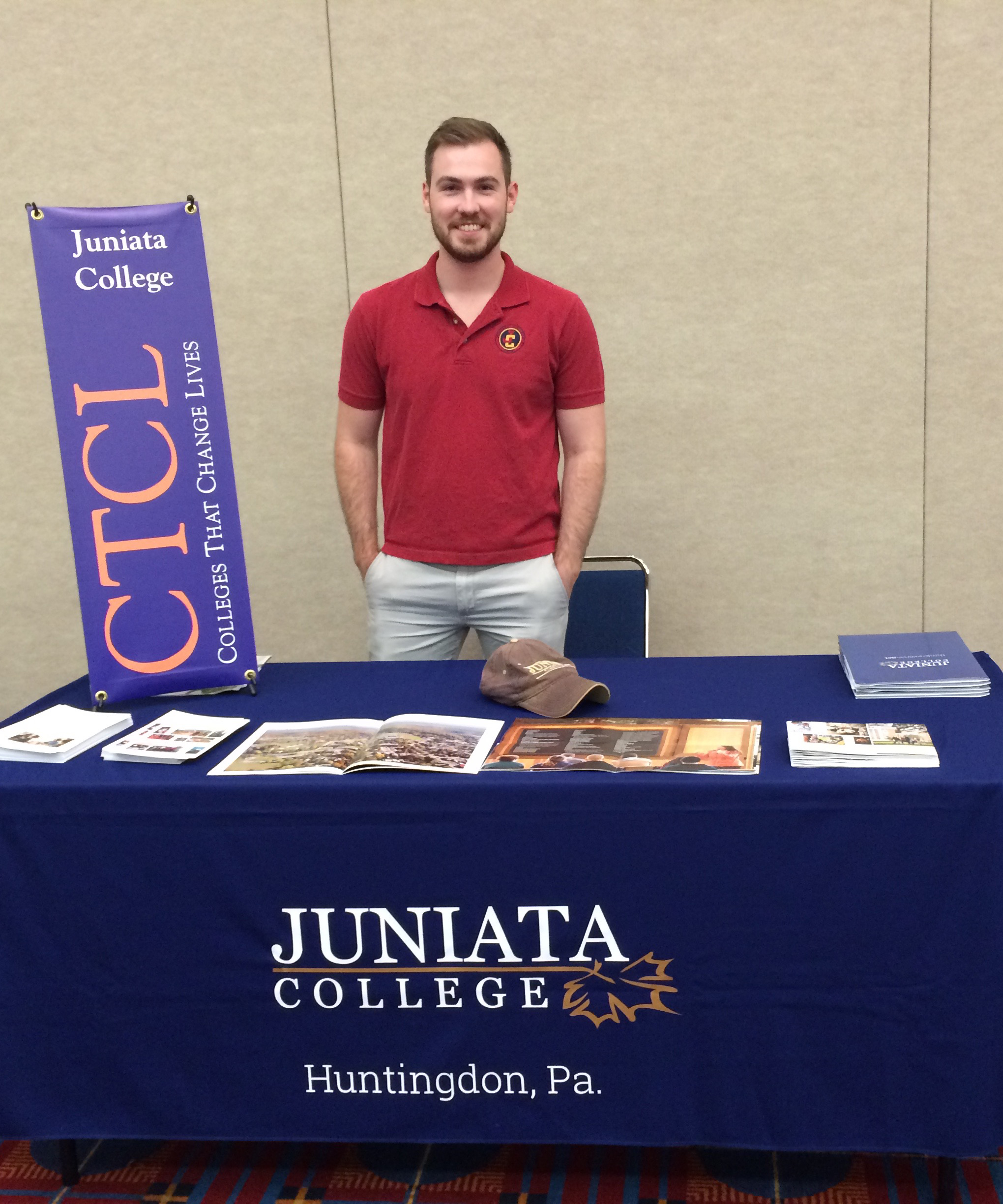Josh Beckel representing Juniata College at a College Fair