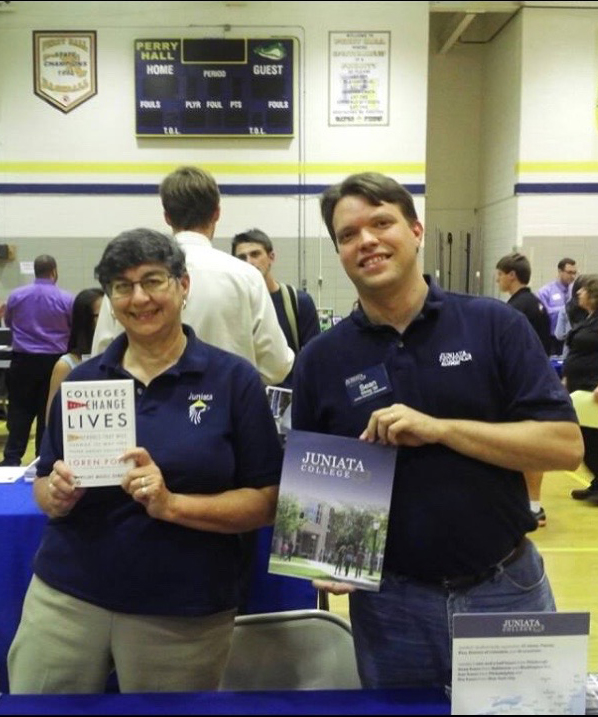 Sandy and Sean representing Juniata College at a College Fair