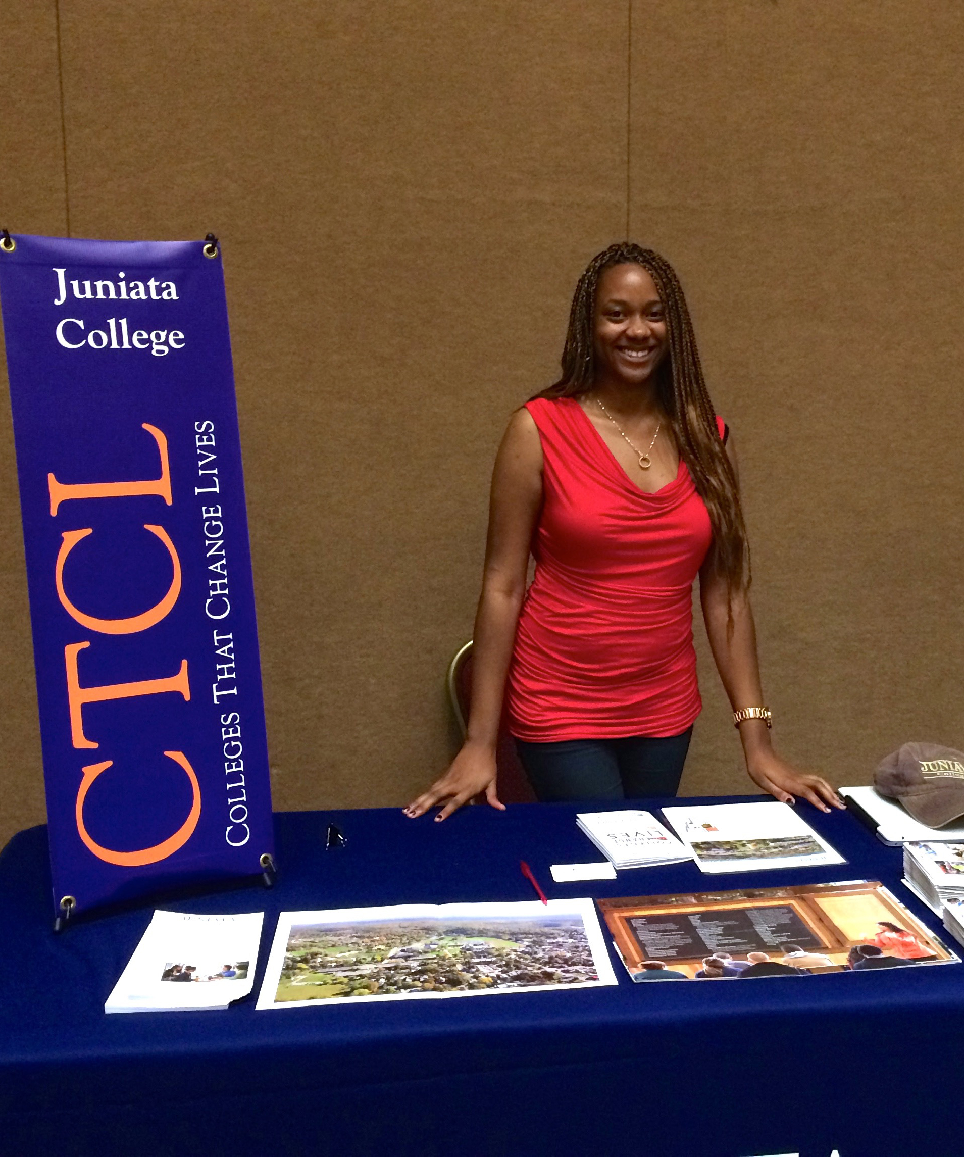 Skakura Woods representing Juniata College at a College Fair