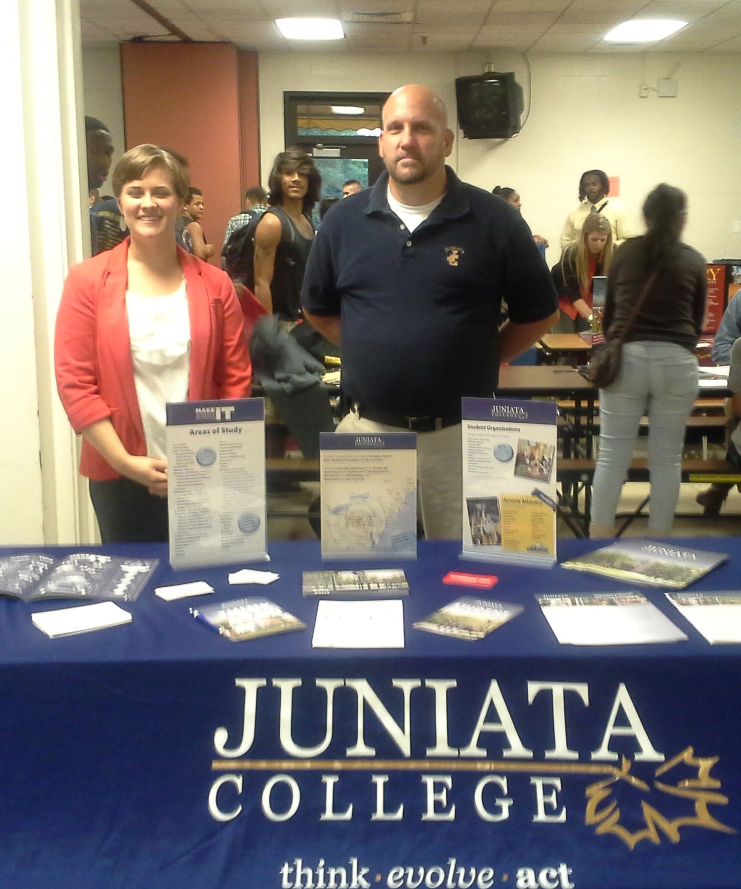 Admission Ambassadors representing Juniata College at a College Fair