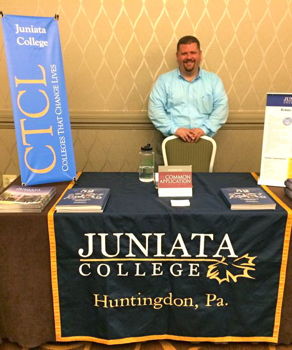 Ty represents Juniata College at a College Fair