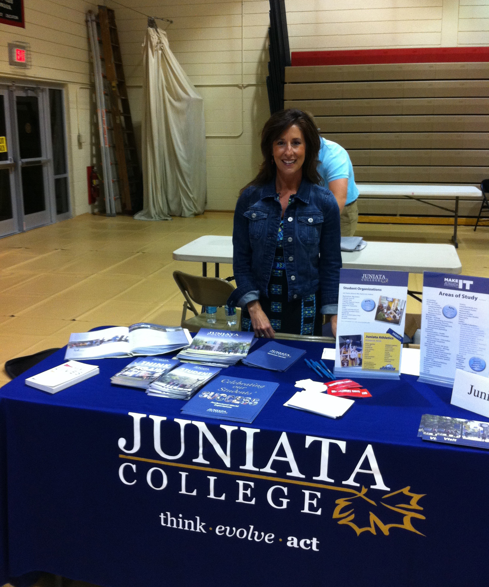 Admission Ambassadors representing Juniata College at a College Fair 4