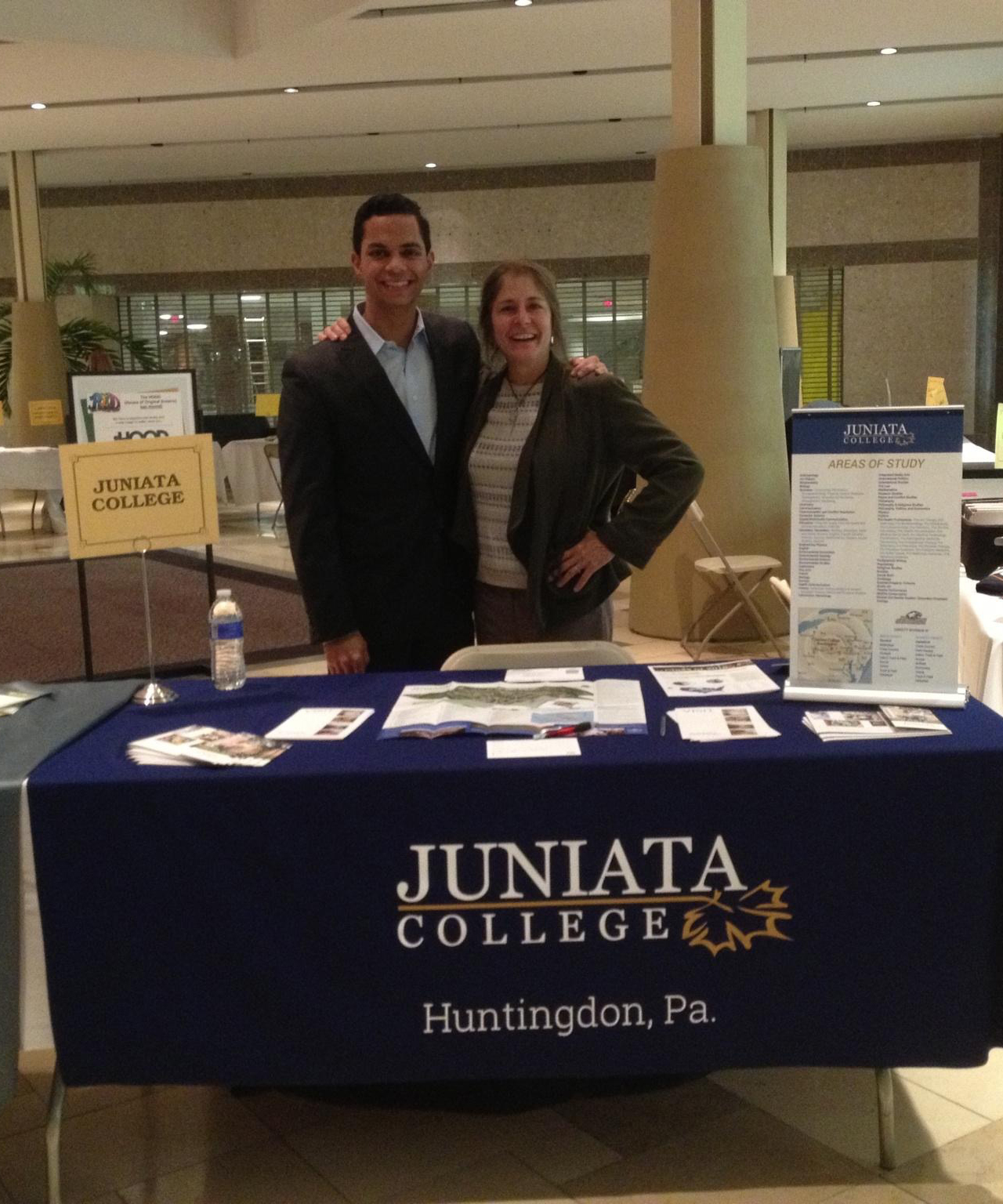 Gabe Castro representing Juniata College at a College Fair
