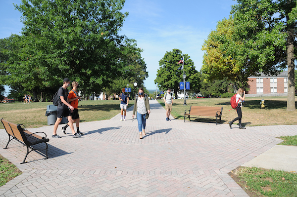 students walking in the middle of Juniata Quad
