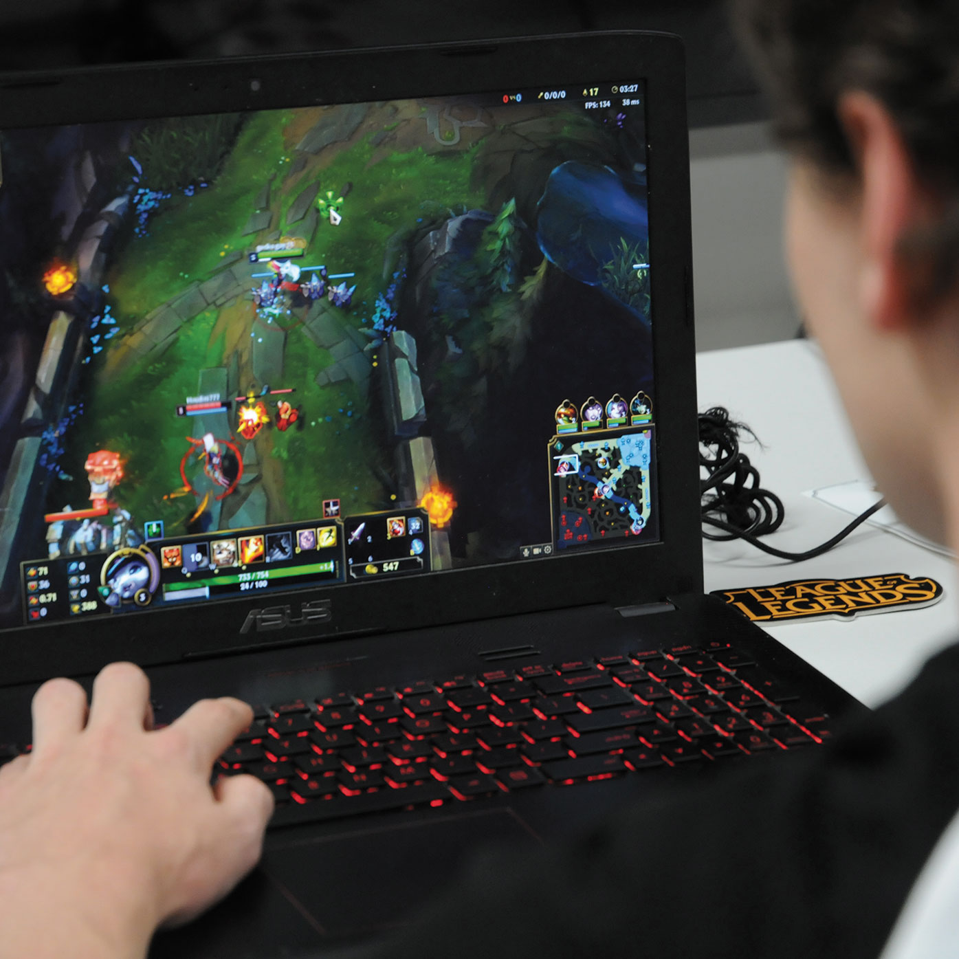 Student playing League of Legends on his laptop