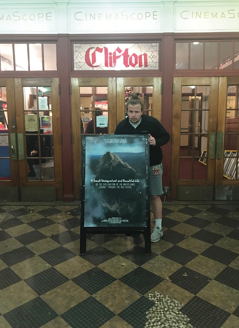 Matthew Gaynor '18 poses in the entry way to Huntingdon Cinemas Clifton 5,