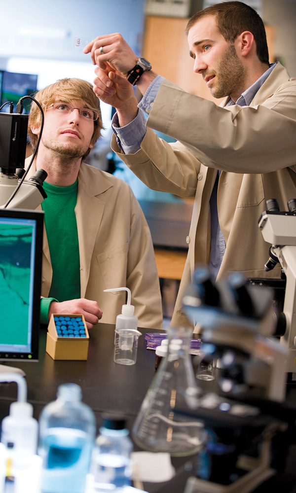 Chris Grant, assistant professor of biology, right, strives to facilitate a collaborative learning environment with his students through research opportunities.