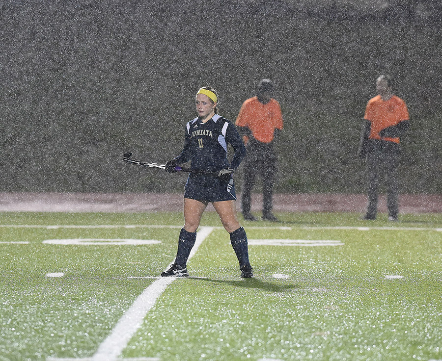 Allison Groft '16 keeps her focus during a torrential downpour.