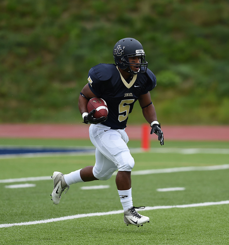 Isaiah Slutter '15 focued and determined to move down the field.
