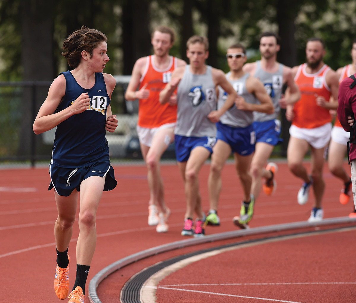 Kevin Schofield '18 looks back to see who might be gaining on him during the Landmark Track Championship.