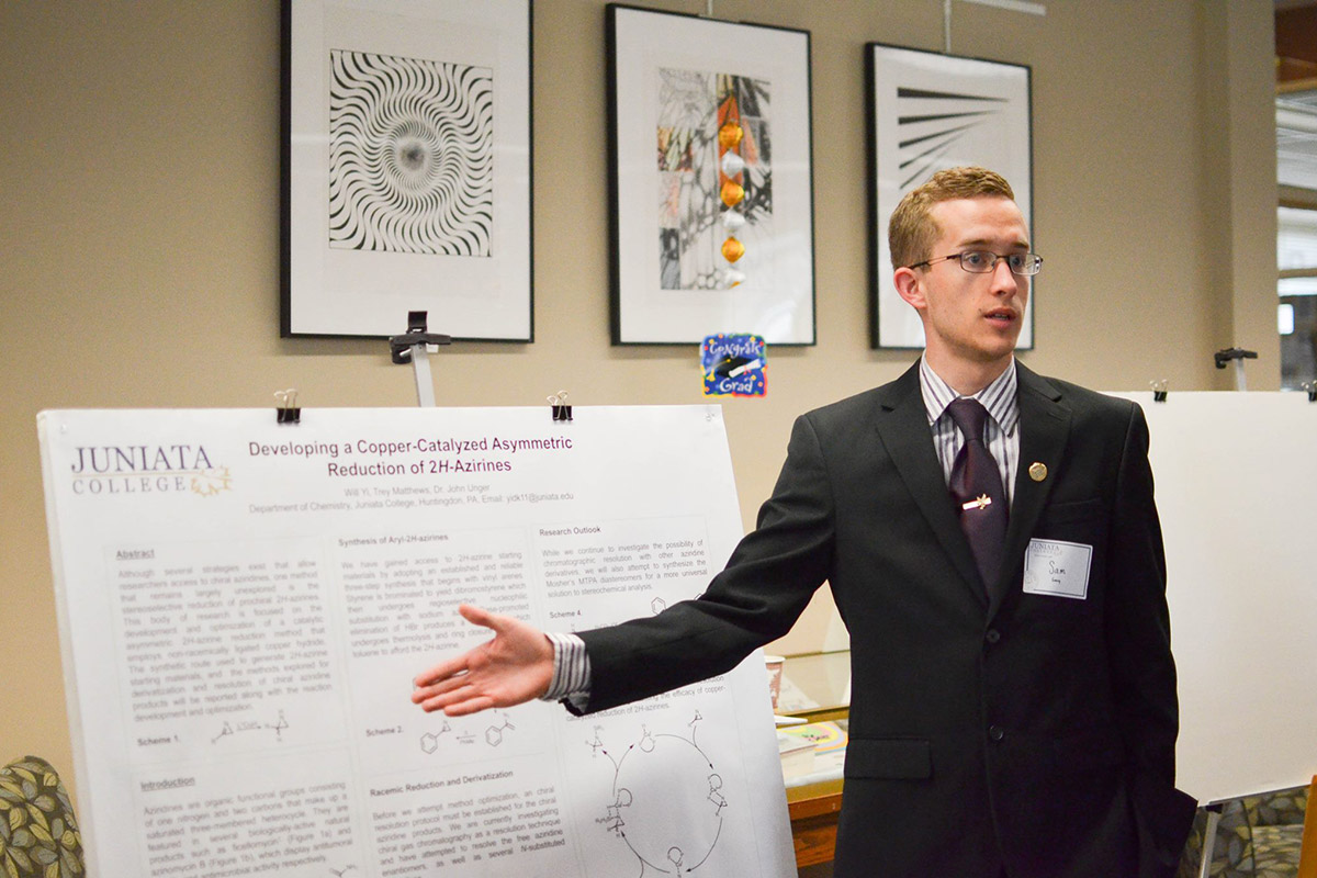Sam Presenting at The Liberal Arts Symposium. Liberal Arts Symposium (LAS) is a campus-wide research conference at which students present their capstone projects, displaying their deep knowledge of many subjects.