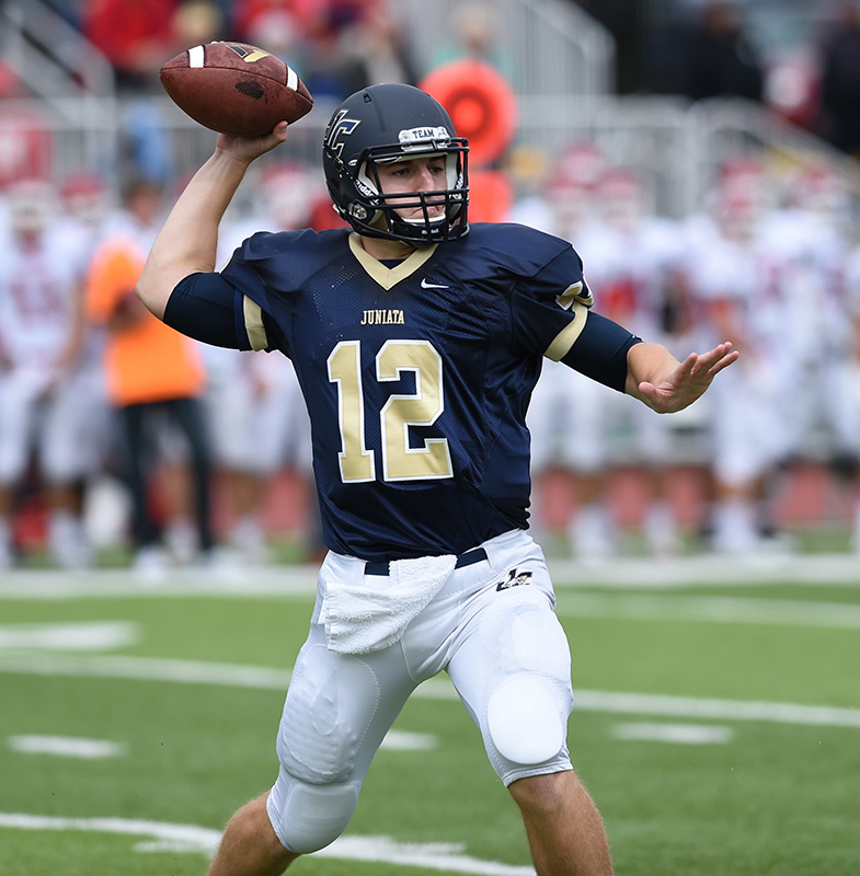 Ward Udinski '15 throwing a passing during the game.